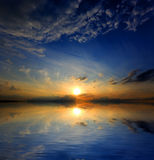 Sunset over water surface Royalty Free Stock Image