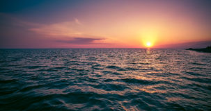 Sunset over water surface of the sea. From the height of bird flight Royalty Free Stock Photography