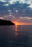 Sunset over the water at a tropical island Royalty Free Stock Photo