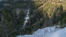 Sunset over Waterfall in Winter Forest in Solden Time Lapse Dolly shot Zoom in stock footage