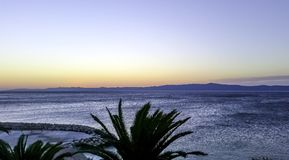 Sunset over waterfront and Adriatic Sea in Makarska, Dalmatia, Croatia. Sunset over waterfront and Adriatic Sea - Makarska, Dalmatia, Croatia Stock Photo