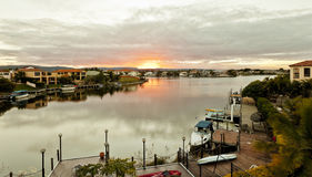 Sunset over waterfront houses Royalty Free Stock Image