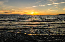 Sunset over the waves. In the evening Royalty Free Stock Image