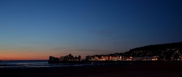 Sunset over Weston Super mare pier and town. Sunset over Weston Super-Mare pier and town Royalty Free Stock Image