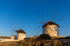 Sunset over White windmills on the island of Mykonos, Greece Stock Images