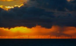 Sunset over wind farm Stock Photo