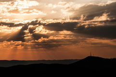 Sunset over Windhoek. Sun among clouds during sunset above Windhoek in Namibia Stock Images