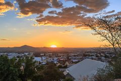 Sunset over Windhoek Central Business district with sun and mountains in the background, Windhoek, Namibia royalty free stock photography