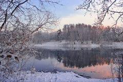 Sunset over winter lake Stock Photos