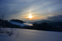Sunset over winter landscape Royalty Free Stock Images