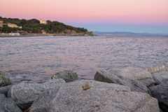 Sunset over winter Ligurian Sea beach. Color image royalty free stock photography