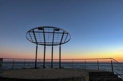 Sunset over winter Ligurian Sea beach. Color image stock image