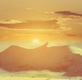 Sunset over a winter mountains Royalty Free Stock Photos