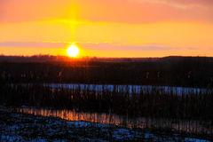 Sunset over a winter river Royalty Free Stock Photo