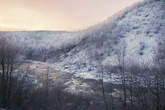 Sunset over winter river. Flowing through the mountains Royalty Free Stock Images
