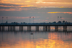 Sunset over a wooden pier Royalty Free Stock Photography
