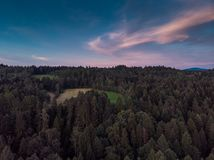 .Sunset over woodlan, aerial drone view royalty free stock photography