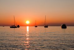 Sunset over yachs and sea. Sunset over yachts and calm sea, Rovigno city Royalty Free Stock Photo