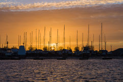 Sunset over yacht harbor Stock Photography