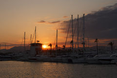 Sunset over yacht harbor Royalty Free Stock Photos