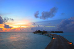 Sunset and overwater villas Stock Photos
