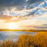 Sunset ower a small blue lake stock image