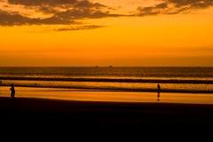 Sunset on Pacific coast of Ecuador. SAN CLEMENTE ECUADOR, FEBURARY-2013 Beach waves and shore Feb 2013 in San Clemente Ecuador.San Clemente is a fishing village Royalty Free Stock Photo