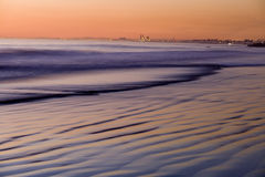 Sunset on the Pacific at Newport Beach. Dusk on the Pacific Ocean at Newport Beach with the coast of southern California in the background royalty free stock images