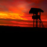 Sunset on Pacific Ocean bay. Resque watch tower on the Pacific Ocean beach in Ecuador during sunset Stock Image