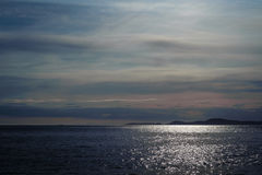 Sunset on Pacific ocean in Deception Pass, royalty free stock image