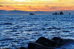Sunset at Pacific ocean from English Bay, Downtown Vancouver, British Columbia Royalty Free Stock Image