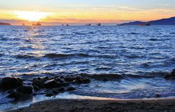 Sunset at Pacific ocean from English Bay, Downtown Vancouver, British Columbia. Canada Stock Photos