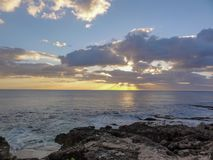 Sunset off the cost of Oahi. A sunset of the Pacific Ocean, off the coast of the island of Oahu in Hawaii Stock Photos