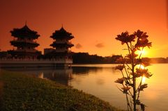 Sunset, pagoda and flower in the park Stock Image