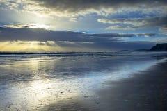 Sun Harp Through Clouds during Sunset over Hauraki Coast Stock Photography