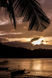 Sunset with Palm Leaf and Boats-Philippines Royalty Free Stock Photos