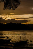 Sunset with Palm Leaf and Boats-Philippines Stock Image