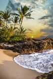 Sunset With Palm Trees, Beach and Ocean in Secret Beach, Maui, Hawaii stock images