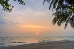 Sunset with Palm trees silhouette in Chang island or Koh Chang Stock Photo