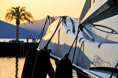 Sunset palm & yacht Stock Images