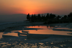 Sunset at Pamukkale. Original site in turkey done by hard water springs that create natural limestone basins full of water Stock Images