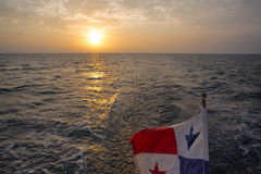 Sunset and Panama Flag waving with the sea in The San Blash Isla Royalty Free Stock Image