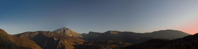 Sunset panorama. Panoramic view. Mountains sunset with blue red sky royalty free stock photos