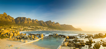 Sunset Panorama Of Camps Bay In South Africa. Sunset panorama of Camps Bay, Cape Town in South Africa stock photo