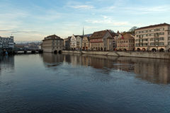 Sunset panorama of city of Zurich and reflection in Limmat River Royalty Free Stock Image