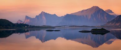 Sunset panorama of Lofoten Islands, Norway. Beautiful summer sunset panorama of Lofoten Islands, Norway, with mountains, fjord, small village and sunshine Royalty Free Stock Images