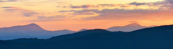 Sunset panorama of mountains Royalty Free Stock Images