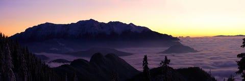 Sunset panorama over Bucegi mountains - Romania. Landscape panorama of Bucegi mountains in winter, Romania Royalty Free Stock Photography