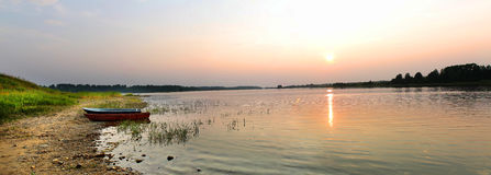 Sunset panorama over the lake. Large-format panorama of a sunset over the lake Stock Image