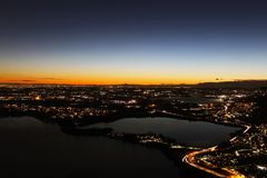 Sunset panorama over northern Lombardy lakes showing light pollution and Alps sihouette in the background. Sunset panorama over northern Lombardy lakes showing royalty free stock photos
